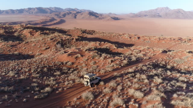 Aerial view of vehicle driving through the beautiful NamibRand Nature Reserve video