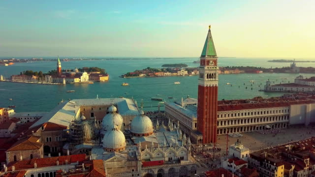 Aerial view of Venice panoramic landmark, aerial view of Piazza San Marco or st Mark square, Campanile and Ducale or Doge Palace. Italy, Europe. Drone shot at sunset