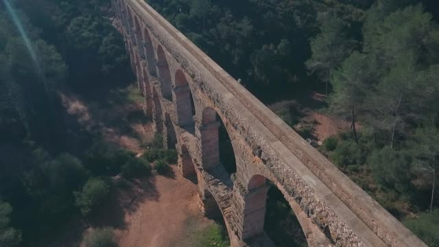 Aerial view of view of the ancient Roman aqueduct. Tarragona, Spain. Aerial view of view of the ancient Roman aqueduct. Tarragona, Spain aqueduct stock videos & royalty-free footage