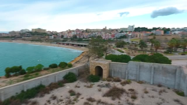Aerial view of view of the concrete walls of the military Fort on the beach in Tarragona, Spain.