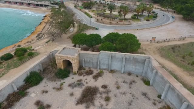 Aerial view of view of the concrete walls of the military Fort on the beach in Tarragona, Spain