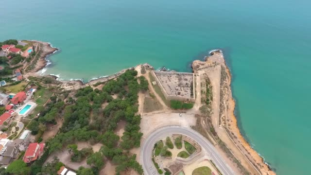 Aerial view of view of the concrete walls of the military fort (Forti de la Reina) on the beach in Tarragona, Spain