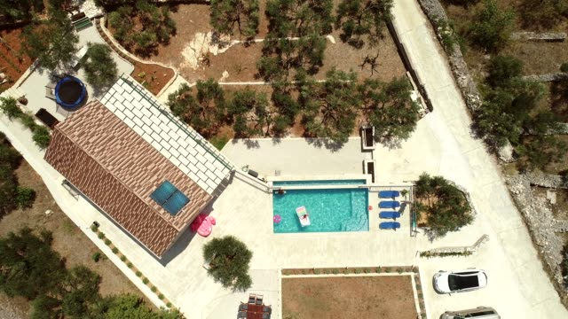 Aerial view of villa with swimming pool.