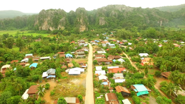 Aerial view of Village with limestone mountain at Noen Maprang in Thailand video
