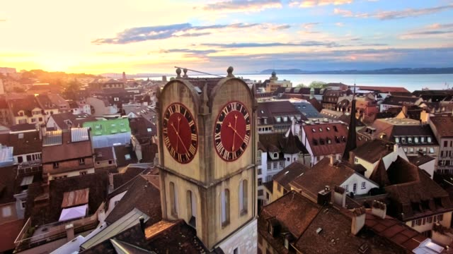 vídeos de stock e filmes b-roll de aerial view of vintage bell-tower in neuchatel, switzerland - suíça
