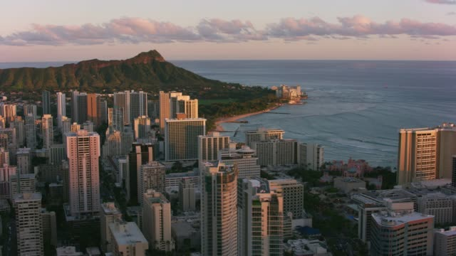 Aerial view of Waikiki and Diamond Head at sunset. Honolulu, Oahu, Hawaii circa-2018.  Aerial view of Waikiki and Diamond Head at sunset.  Shot with Cineflex and RED Epic-W Helium. waikiki stock videos & royalty-free footage