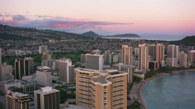 Aerial view of Waikiki at sunset. Honolulu, Oahu, Hawaii circa-2018.  Aerial view of Waikiki at sunset.  Shot with Cineflex and RED Epic-W Helium. waikiki stock videos & royalty-free footage