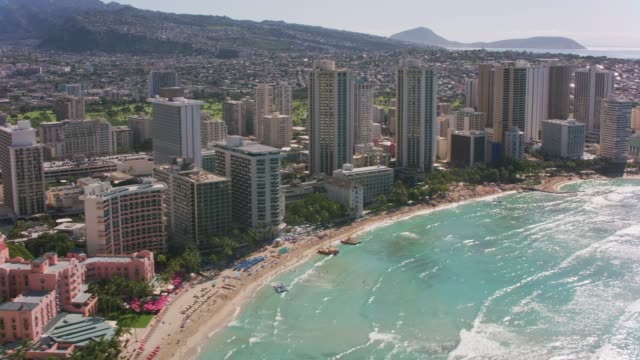 Aerial view of Waikiki Beach. Honolulu, Oahu, Hawaii circa-2018.  Aerial view of Waikiki Beach.  Shot with Cineflex and RED Epic-W Helium. waikiki stock videos & royalty-free footage
