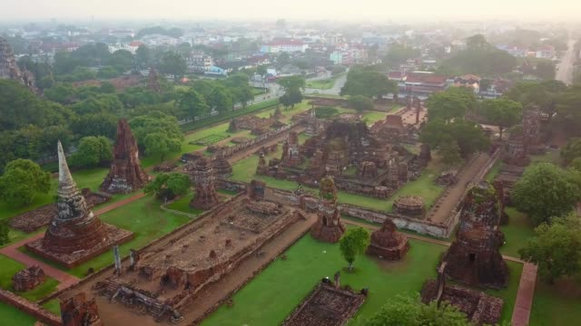 Aerial view of Wat Mahathat is a Buddhist temple, Part of the Ayutthaya World Heritage Historical Park, Thailand Aerial view of Wat Mahathat is a Buddhist temple, Part of the Ayutthaya World Heritage Historical Park, Thailand in sunrise bagan stock videos & royalty-free footage