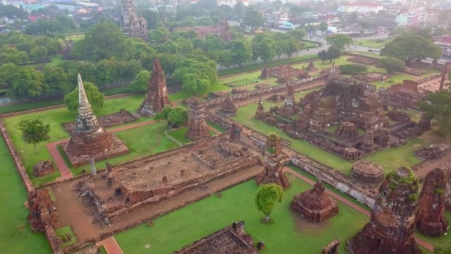 Aerial view of Wat Mahathat is a Buddhist temple, Part of the Ayutthaya World Heritage Historical Park, Thailand Aerial view of Wat Mahathat is a Buddhist temple, Part of the Ayutthaya World Heritage Historical Park, Thailand at Sunrise bagan stock videos & royalty-free footage