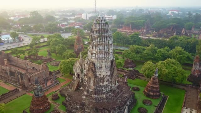 Aerial view of Wat Ratchaburana is a Buddhist temple in the Ayutthaya Historical Park, Ayutthaya, Thailand. The temple's main prang is one of the finest in the city Aerial view of Wat Ratchaburana is a Buddhist temple in the Ayutthaya Historical Park, Ayutthaya, Thailand at Sunrise bagan stock videos & royalty-free footage