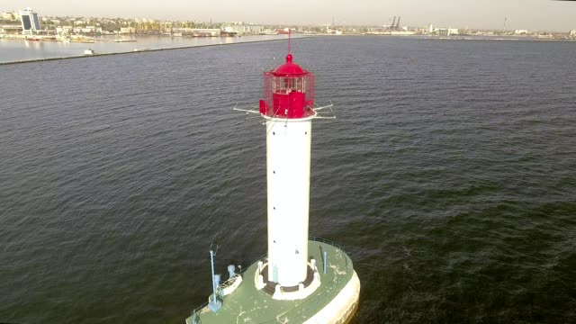 Aerial view of white lighthouse. Sea Port of Odessa. Ukraine. Black Sea. video