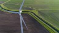 istock Aerial CU view Of Wind Farm On Countryside Field 1249448148