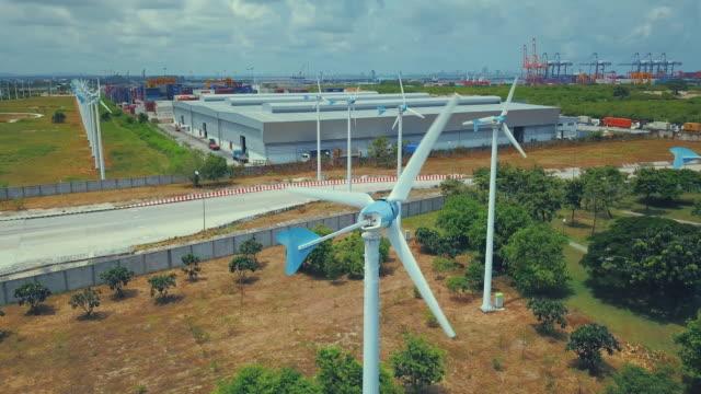 Aerial view of wind turbine in industrial port video