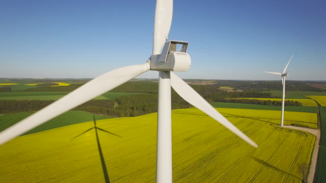 Aerial view of wind turbine Aerial view of wind turbine, UHD, 4K (3840X2160) windmill stock videos & royalty-free footage