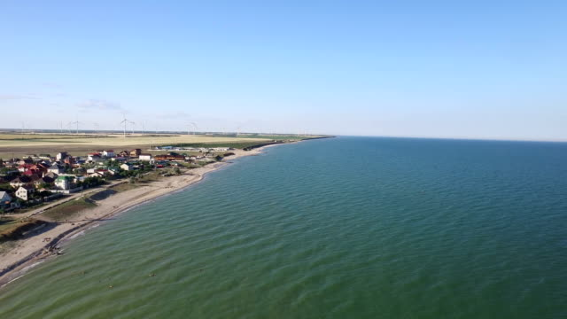 Aerial view of wind turbines at sea energy. Aerial shot video
