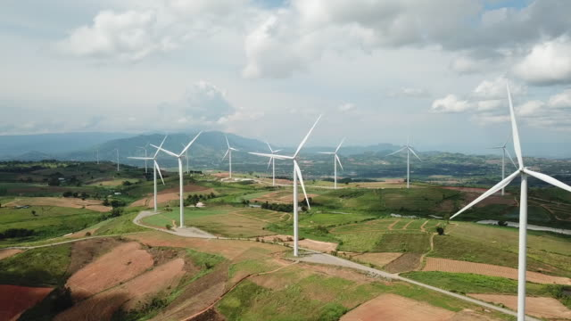 aerial view of wind turbines - turbina a vento video stock e b–roll