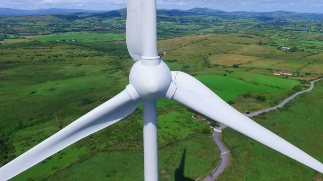 Aerial view of wind turbines Ultra close up footage filmed with a drone of wind turbines. mill stock videos & royalty-free footage