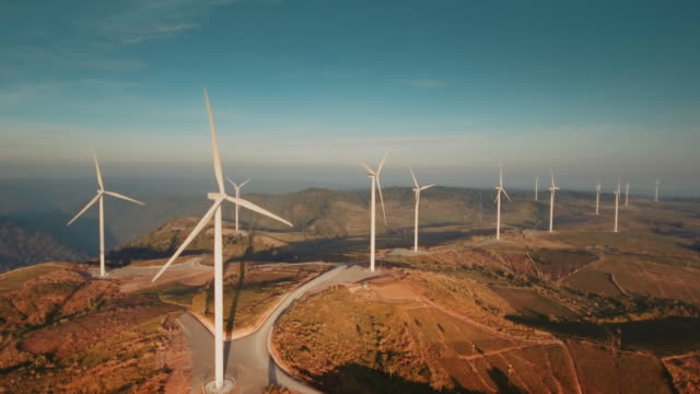Aerial view of wind turbines Aerial view of wind turbines power stock videos & royalty-free footage