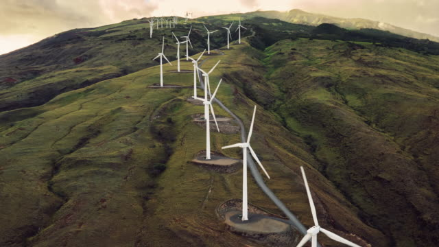 Aerial view of windmills turning at sunset video