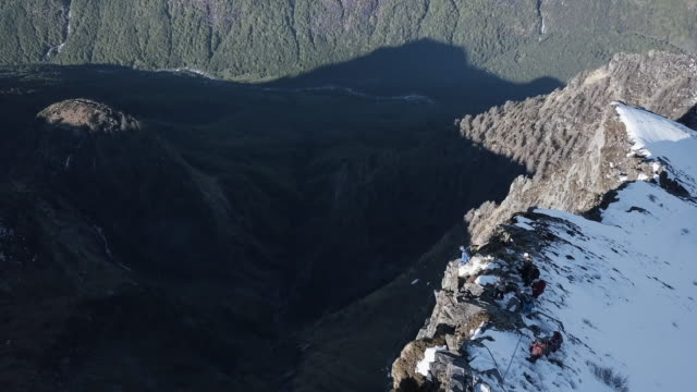 Aerial view of wingsuit pilot jumping off alpine cliff video