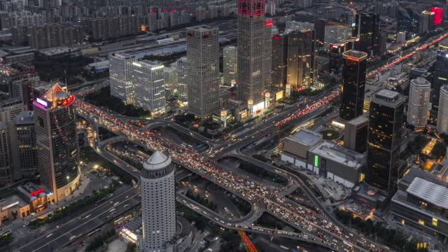 T/L WS HA ZO Aerial View of Wonderful City Scene and Crowded Traffic, Day to Night Transition / Beijing, China video