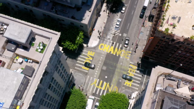 aerial view of words painted on city street during george floyd protests - заколоченный стоковые видео и кадры b-roll