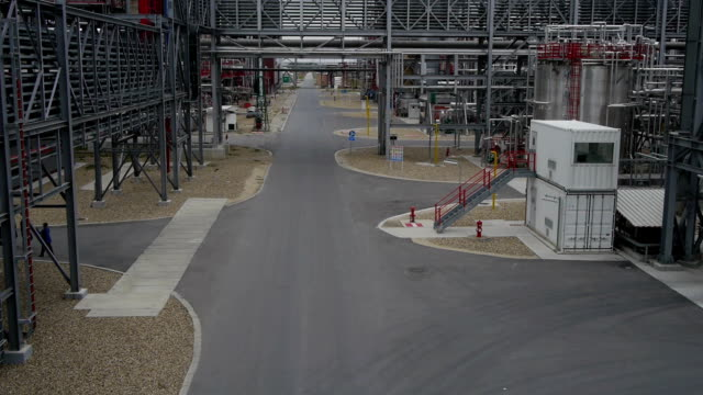 Aerial view of worker pass through industrial facility video