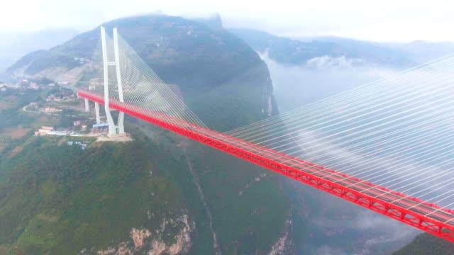 aerial view of world's highest suspension bridge, beipanjiang, ghuizhou, china - bridge filmów i materiałów b-roll