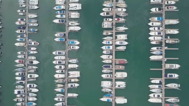 Aerial view of Yacht and sailboat parking video