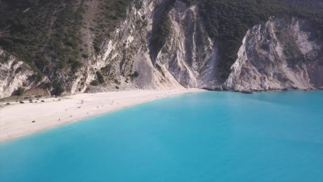 Aerial view on the beach of Myrthos in Kefalonia, Greece Aerial view on the beach of Myrthos in Kefalonia, Greece greek islands stock videos & royalty-free footage