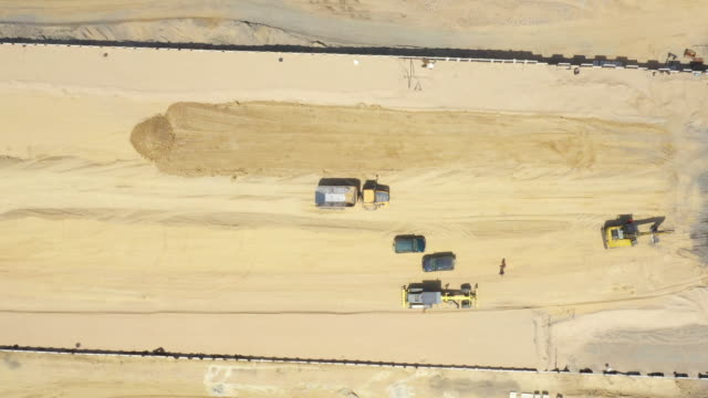 Aerial view on the new road construction site. Highway