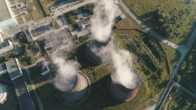 aerial view on the working power station. cooling tower of nuclear power plant. coal-burning power plant. view from above - reattore nucleare video stock e b–roll