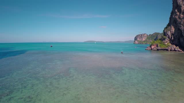 Aerial view on tropical beach in Thailand Aerial view on tropical beach (Pranang beach) and rocks, Krabi, Thailand, 4k phuket province stock videos & royalty-free footage