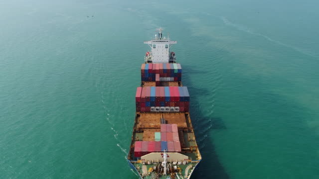 Aerial view or front view container ship from sea port driving on the sea for logistic import export or transportation.