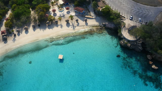 aerial view over a beach on the beautiful island of  Curacao - Caribbean Sea View about the known beach named Groote Knip / Curaçao /Netherlands Antilles curaçao stock videos & royalty-free footage