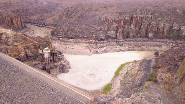 Aerial view over a dried up dam