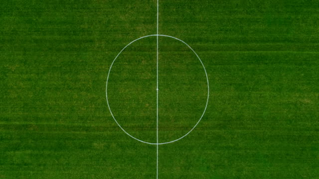 aerial view over a green soccer field - football field stock videos & royalty-free footage