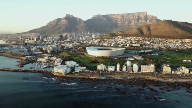 Aerial view over Cape Town, to Table Mountain Cape Town and Table Mountain, South Africa, aerial view table mountain national park stock videos & royalty-free footage