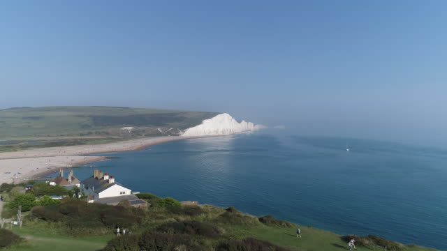aerial view over cuckmere haven moving out to sea - south downs video stock e b–roll