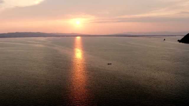 Aerial View over Danube River at Sunset. Drone Flying over Boats on Water. Autumn, Sun, Travel destinations, Tourism, Exploration, Adventure, Frontier, Harmony, Tranquility, stock video