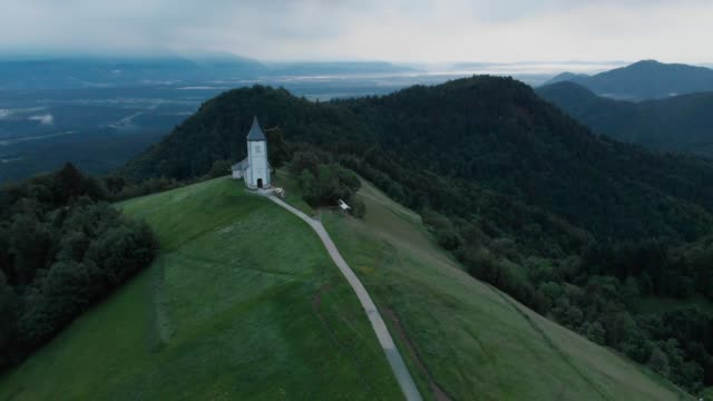 Aerial view over Lonely Chapel of St. Primus and Felician, Jamnik, Slovenia