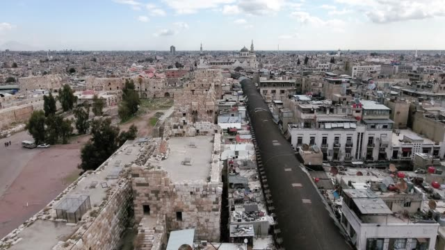 Aerial view over souk of Damascus in Syria. We can see the rooftop of the souk all over the street Aerial view over souk of Damascus in Syria. We can see the rooftop of the souk all over the street. Perfect panoramic view the city of Damascus damascus stock videos & royalty-free footage
