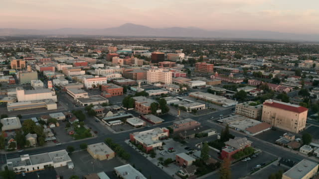 Aerial View Over The Desert Town of Bakersfield in Southern California Aerial view over the central business district in Bakersfield California USA at sunset california stock videos & royalty-free footage