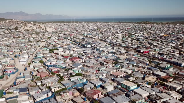 Aerial view over township in South Africa Aerial overhead South African township cape town stock videos & royalty-free footage