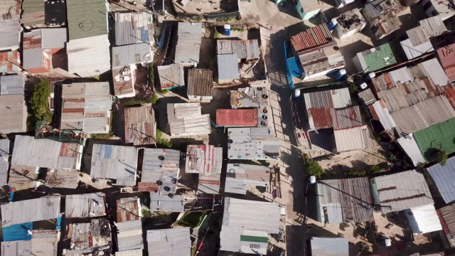 aerial view over township in south africa - capanna video stock e b–roll