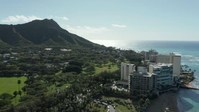 Aerial view panning from ocean in Waikiki towards Diamond Head on Oahu