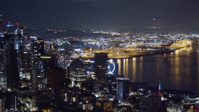 Aerial View Panning Shot of the Seattle Skyline and Puget Sound (Elliott Bay) at Night