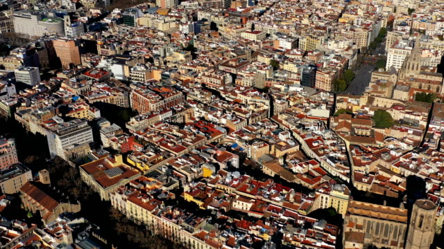 aerial view panorama to Barcelona Spain from Gothic Quarter to center with Sagrada familia and Torre Glories Torre Agbar. Video footage - video