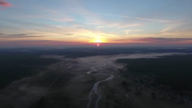 Aerial View. Panoramic summer morning landscape. The picturesque landscape with river, dam on the river, trees and field with Incredible sun. Morning Fog. Aerial View. Panoramic summer morning landscape. The picturesque landscape with river, dam on the river, trees and field with Incredible sun. Morning Fog. kazakhstan stock videos & royalty-free footage